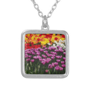 "Spring Fling Necklace Celebrate the beautiful colors of the spring season with this lovely necklace. The bold colors of the tulip provide an array of hues that will be perfect for your spring/summer collection. Wear this necklace anytime you want to put a little pop of color into your life and wardrobe. A beautiful square custom sterling silver plated necklace. Complete with a 18"" sterling silver-plated chain (2"" extender) and lobster claw clasp, this necklace is finished with a UV resistant and waterproof coating to protect your imagery for years to come. The necklace arrives in a special black felt bag that is perfect for gifting. Sterling Silver-Plate. Made in the USA. UV Resistant and waterproof. Add photos, artwork and text. Charm diameter: .75"". Chain length: 18"" with 2"" extender."